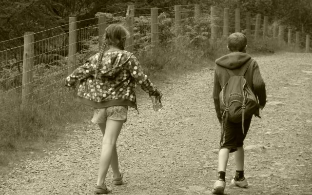 boy and girl walking away