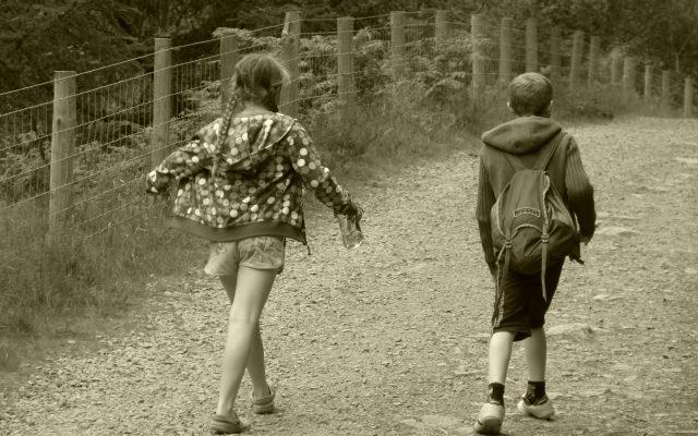 boy and girl walking away